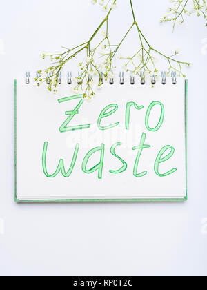Zero waste concept with hand written letters on white page of a note pad - Stock Photo