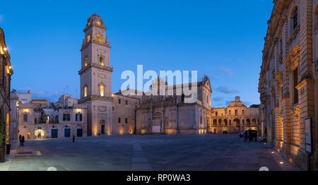 Piazza del Duomo square , Campanile tower and Virgin Mary Cathedral (Basilica di Santa Maria Assunta in Cielo) in Lecce - Puglia, Italy at night - Stock Photo