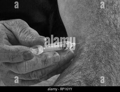 An close up image in back and white of a man holding a syringe with the needle inserted into his arm having just injected himself with its contents - Stock Photo