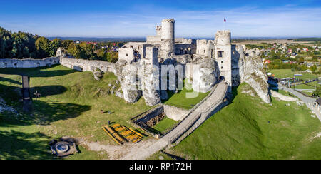 Wide panorama of the ruins of medieval castle on the rock in Ogrodzieniec, Poland. One of strongholds  called Eagles Nests in Polish Jurassic Highland - Stock Photo