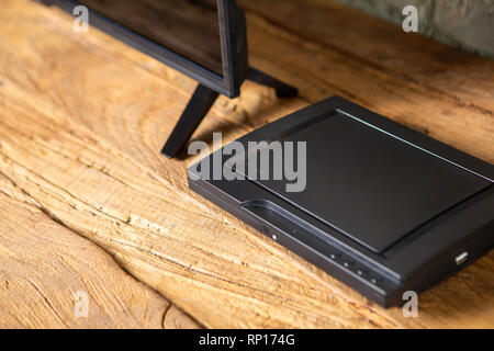Compact DVD player in the interior on the TV Cabinet - Stock Photo