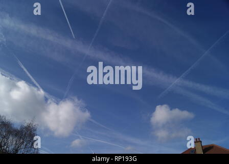 Chemtrails from Geo-engineering of weather over Barkingside, Ilford, UK. Cloud forming micro-particles are sprayed high up into the air. - Stock Photo