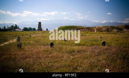 Kurgan stelae aka Balbals and Burana tower in Tokmok,Chuy Valley Kyrgyzstan - Stock Photo
