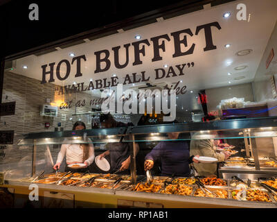 Chinese hot buffet selection 'eat as much as you like' window with patrons selecting a variety of Chinese food Wardour Street Chinatown Soho London UK - Stock Photo