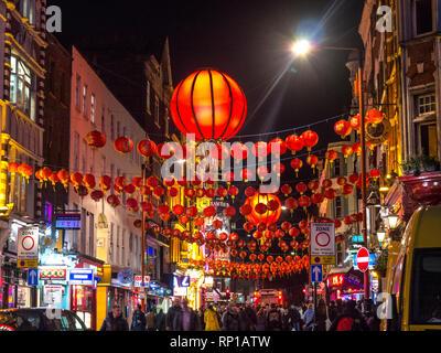 Chinatown London Soho Chinese lanterns lit up on a busy night in Wardour Street Chinatown Soho London UK - Stock Photo