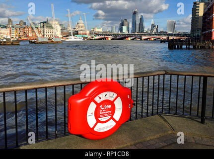 London, England, UK. Emergency lifebelt on the South Bank of the River Thames - City of London skyline - Stock Photo