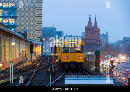 Berlin, Germany. The Warschauer Strasse subway station in winter at sunset - Stock Photo