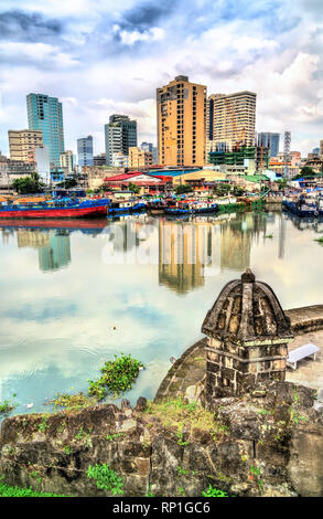View of the Pasig River from Fort Santiago in Manila, the Philippines - Stock Photo