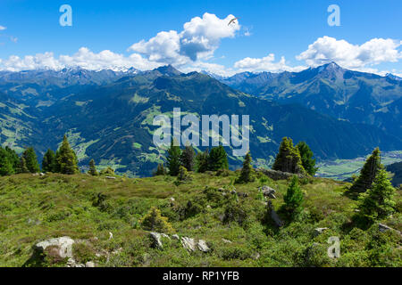 Summer mountain landscape with blue cloudy sky and hang glider. Austria, Tyrol, Zillertal Valley, Zillertal High Alpine Road. - Stock Photo