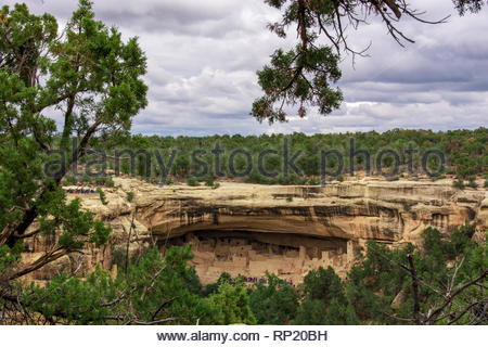 stunning view of Cliff Palace village in Mesa Verde National Park on a cloudy day - Stock Photo