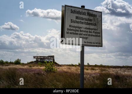 Warning signs at the Bundeswehr firing range and military training area of the Wehrtechnische Dienststelle fŸr Waffen und Munition 91 (WTD 91) in Meppen. - Stock Photo