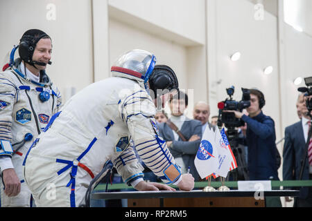 Star City, Russia. 20th Feb, 2019. International Space Station Expedition 59 crew member Alexey Ovchinin of Roscosmos signs in for the final pre-launch qualification exams February 20, 2019 at Star City, Russia. The crew of Christina Koch, Alexey Ovchinin and Nick Hague will launch March 14th from the Baikonur Cosmodrome in Kazakhstan on the Soyuz MS-12 spacecraft for a six-and-a-half month mission on the International Space Station. Credit: Planetpix/Alamy Live News - Stock Photo