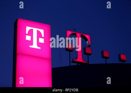 Bonn, Germany. 13th Feb, 2019. The Deutsche Telekom logo lights up on the roof of the company's headquarters. The company publishes the balance sheet figures for the year 2018 on 21.02.2019. Credit: Oliver Berg/dpa/Alamy Live News - Stock Photo