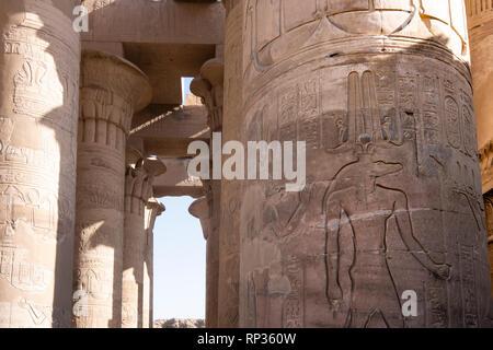 Crocodile headed god Sobek carved in stone at Kom Ombo temple - Stock Photo