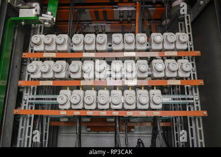 An old fuse box with cables. Old electrical panel, electrical box, control panel. - Stock Photo