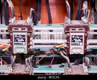 Closeup old electric distribution case in factory.  Insideelectric distibution case - Stock Photo