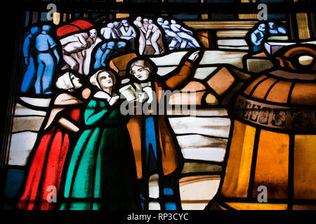 Stained glass window with a religious scene, Notre-Dame Basilica, Old Montreal, Quebec, Canada - Stock Photo