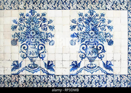 Blue traditional Portuguese ceramic tiles azulejos. Facade, wall decoration of old Coimbra university building, Portugal. Decorative background with - Stock Photo