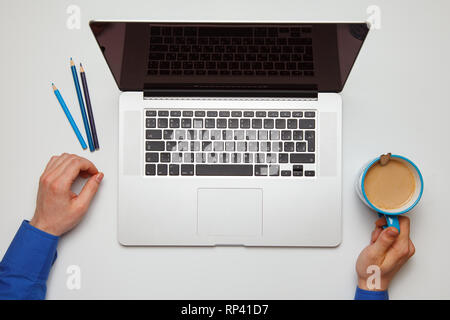 Rest with coffee after work with a laptop. top view - Stock Photo