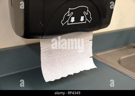 Paper towels for drying hands after washing them to keep them clean - Stock Photo