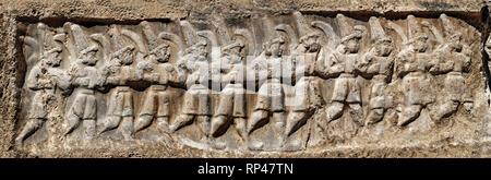 Sculpture of the twelve gods of the underworld from the 13th century BC Hittite religious rock carvings of Yazılıkaya Hittite rock sanctuary, chamber  - Stock Photo
