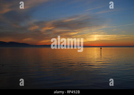 Lindau, Germany: A view of the Bodensee (aka Lake Constance), in the distance Austria, and Switzerland, at sunset in the summer. Position in Lindau: p - Stock Photo