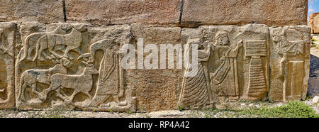 Pictures & Images Hittite relief sculpted orthostat panels of the Sphinx Gate. Left panel depicts a man leading goats to be sacrificed (right) a king  - Stock Photo
