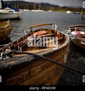 Wooden boat on the edge of a lake. - Stock Photo