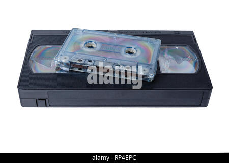 audio tape cassette and VHS video tape cassette on white background, isolated - Stock Photo