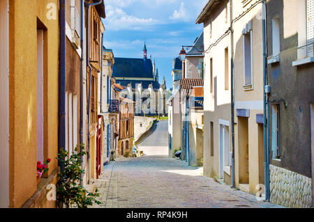 Solitary Rue de Chateau street in the city center of a small town Thouars, France. Many colorful houses down the road. Warm spring morning, vibrant bl