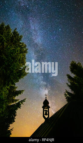 milky way with chapel silhouette background at dark sky park winklmoos in bavaria, travel sternenpark reit im winkl - Stock Photo