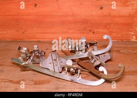 Vintage ice skates on wooden background - Stock Photo