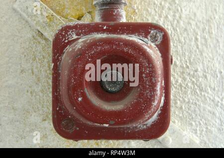 Old electrical switch. Vintage industrial switch on the wall. - Stock Photo