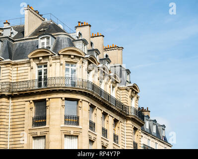 Typical Parisian architecture in central Paris with luxury apartments, big windows and mansards - Stock Photo