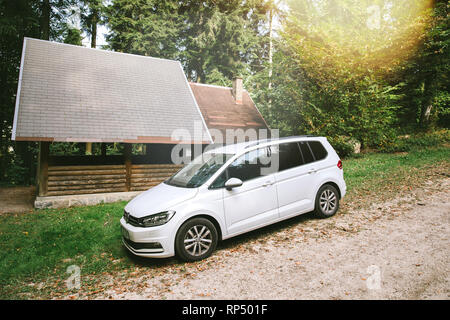 GERMANY - OCT 10, 2018: White VW Volkswagen sharan van parked on a forest rural road in Black Forest  - Stock Photo