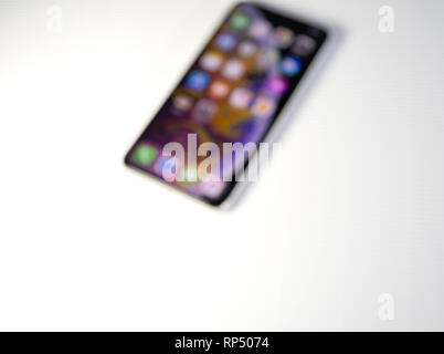 PARIS, FRANCE - SEP 27, 2018: Defocused view of new iPhone Xs Max smartphone model by Apple Computers - Stock Photo