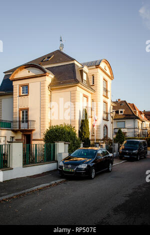 STRASBOURG, FRANCE - DEC 19, 2018: Beautiful building with Volkswagen car limousine and van parked on the street - Stock Photo
