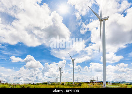 Beautiful landscape many windmills under the sun on blue sky and clouds background, Clean energy that is environmentally friendly at Khao Kho, Phetcha - Stock Photo