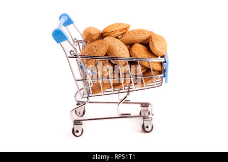 Shopping cart with raw almond isolated on white background - Stock Photo