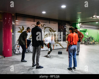 STRASBOURG, FRANCE - OCT 13, 2018: Group of young people breakdancing on the street corner - modern hip-hop dancing training modern subculture - Stock Photo