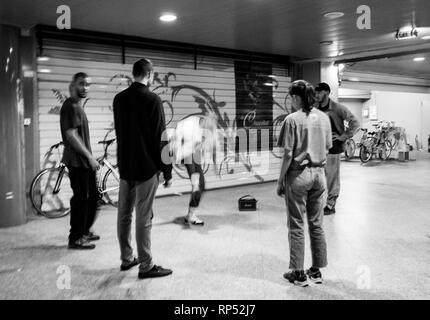 STRASBOURG, FRANCE - OCT 13, 2018: Black and white young people breakdancing on the street corner - modern hip-hop dancing training modern subculture black and white - Stock Photo