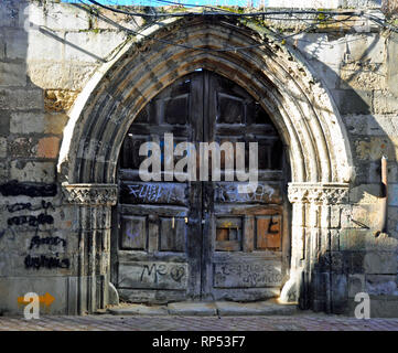 Ancient wooden doorway off street alley in Leon, Spain. - Stock Photo