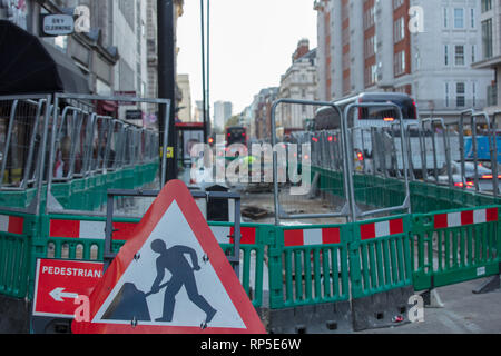 Large project changing paving of the streets of central London in and around Oxford street. Temporary inconvenience for pedestrians and other traffic. - Stock Photo