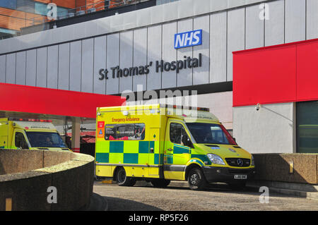 A Mercedes Benz ambulance is parked outside St Thomas' Hospital Emergency Department (A&E) in London on a sunny day. - Stock Photo