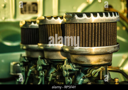 Top Half of a Engine in a Classic Car - Stock Photo