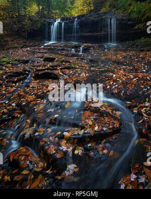 Mohawk Falls in autumn at Ricketts Glenn State Park, Pennsylvania - Stock Photo