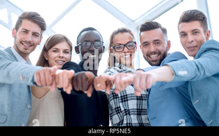 Portrait of excited young business people pointing at you - Stock Photo