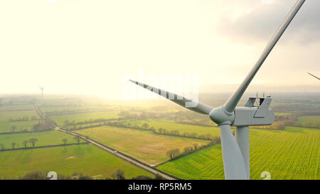 Aerial photo of wind turbines at sunset in Sainte Pazanne, France - Stock Photo