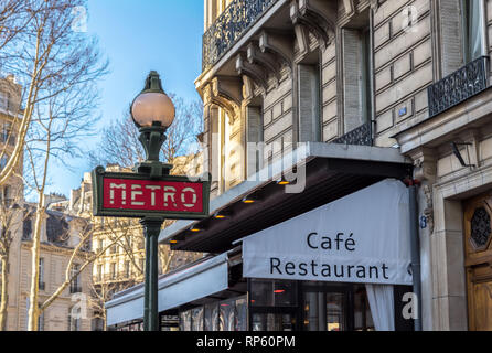 A traditional metro sign in Paris - France - Stock Photo