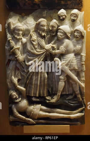 Kiss of Judas Iscariot and Arrest of Jesus depicted in one of the alabaster panels with scenes of the Passion of Christ from the Nottingham Workshops (England) dated from the 15th century on display in the Carmo Archaeological Museum (Museu Arqueológico do Carmo) in the former Carmo Convent (Convento do Carmo) in Lisbon, Portugal. - Stock Photo